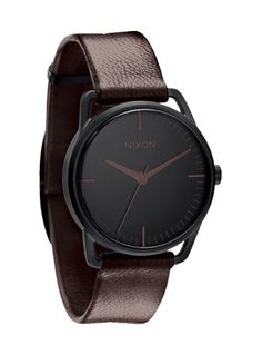 "A leather-banded watch says ""casual"" while the dark face says ""mysterious."""