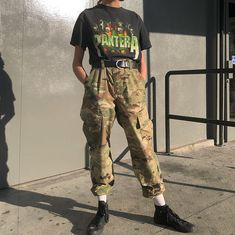 """A blazin' look just posted to site. ☄️ 90s vintage Pantera tee. Size small- large and $42+shipping. Paired with camo cargo trousers with cinched ankle detailing. Waist 32"""" shown belted on size 2 and will fit up to size 6. $62+ shipping."""