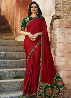 * Saree Fabric :- Embroidered Sparkle Silk and Work * Saree Color :- Red  * Saree Length :- 5.5 M. * Saree Work :- Resham Work, Zari, Stone Work, Sequins  * Blouse Fabric :- Banglory Silk and Work * Blouse Color :- Green * Blouse Length :- 0.80 M. * Blouse Work :- Embroidery * Blouse type :- Un-Stitched   * Wash Care :- First Home Wash. * Quality:- Good Quality Product. * Occasion:- Festival, Party-wear, Wedding, Ceremony.  Please Note: 1. The Shades May Vary Slightly from The Colors…