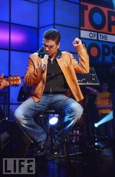 """George singing a cover of """"The Grave"""" on Top of the Pops in 2003. It was the first time he'd performed on the show in 17 years."""