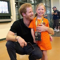 Prince Harry and an adorable young friend. Cuteness overload.                                                                                                                                                                                 More