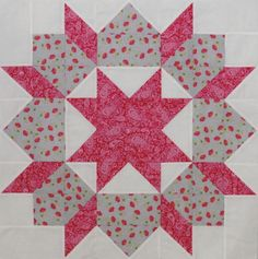 """The first Swoon Block in a series of 16 intended to result in a bed quilt for me!  Made from a stack of fat quarters from Lily Ashbury's """"High Street"""" line from Moda fabrics."""