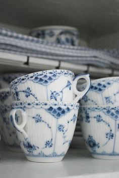 Cupboard stacked with teacups in Royal Copenhagen's Blue Fluted half lace.