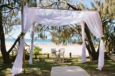 Vintage Canopy with Beach Backdrop www.firstclassfunctions.com.au