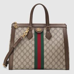 ba00eb05407f Shop the Ophidia GG medium top handle bag by Gucci. Imbued with  retro-inspired