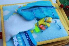 can you believe the zippered cloud with strings of raindrops? amazing quiet book page!