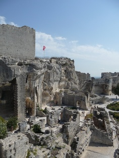 Les Baux de Provence: one of the most beautiful villages of Provence. On top of the hill giving visitors fantastic views, an old fortress with an amazing history to it and not to forget the 2 Michelin start restaurant l'Oustau de Beaumaniere