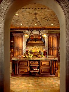 Mediterranean kitchen with a cool archway entrance with another arch mimicked over the stove.