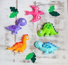 Felt hanging toys set - Dinosaurs set  - pack of 5 by MiracleInspiration on Etsy https://www.etsy.com/listing/162949384/felt-hanging-toys-set-dinosaurs-set-pack