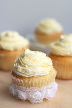 Vanilla Cupcakes - Ingredients are listed in metric; in cups: Cupcakes:        1 1/2 cups self-rising flour      1 1/4 cups all-purpose flour      1 cup (2 sticks) unsalted butter, softened      2 cups sugar      4 large eggs, at room temperature      1 cup milk      1 teaspoon vanilla extract