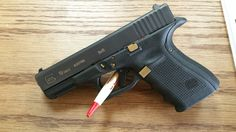 Glock with gold trim