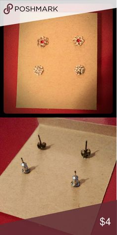 *2 for $6* Silver flower earrings Cute silver flower earrings, one set with red jewel in the middle. Slight discoloration to backs, still in good condition.  *2 for $6*  check out other items with the same label to pair this with for discounts! Jewelry Earrings