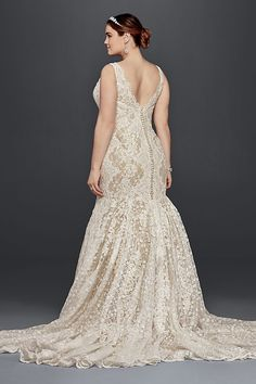 49b2be82463 Head-to-toe lace is the star of this trumpet plus size wedding dress