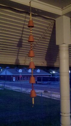 Mini Terra Cotta Pot wind-chime or can be hung up-right as a flowing rain gauge. -Becky