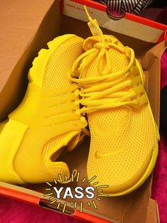 ef92e4615229d A pair of Yellow running shoes. Brooke-Lyn · Nikes