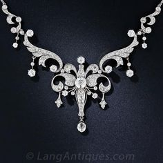 A rare, regal and wonderful antique diamond necklace, dating from the turn-of-the-twentieth century, is superbly handcrafted in platinum over gold. This majestic jewel centers on a bright and sparkling 1.75 carat European-cut diamond radiating from within a graceful scroll motif centerpiece with a 1.22 carat briolette diamond dancing below. The diamond-set scroll theme continues upward with two more sparkling sections. 10.00 carats total weight.