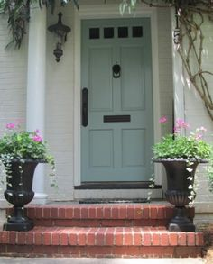 Love this front door color. The door color is Benjamin Moore Wythe Blue; door handle set is by Weslock; exterior paint color is unknown but is close to Benjamin Moore China White or Pratt and Lambert Gray Moire. Door Paint Colors, Front Door Colors, Paint Colors For Home, Exterior House Colors, Exterior Paint, Exterior Shutters, Cottage Exterior, Wythe Blue, Benjamin Moore Colors