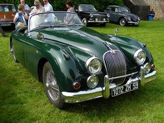 British racing green Jaguar XK 150.   I WOULD LOVE TO OWN ONE OF THESE!