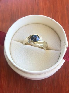 Engagement ring with blue sapphire and diamond accent stones Blue Sapphire, Stones, Engagement Rings, Diamond, Jewelry, Rings For Engagement, Rocks, Wedding Rings, Jewlery