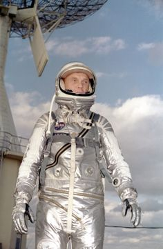 Astronaut John H. Glenn Jr. in his silver Mercury spacesuit during pre- flight training activities at Cape Canaveral. On February 20, 1962 Glenn lifted off into space aboard his Mercury Atlas (MA-6) rocket and became the first American to orbit the Earth.