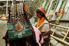 Pakistan | Kalash women prepare their plaiting-based and shell-based headdress. Bumboret. | ©Antoine Serra