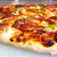 This recipe produces a pizza base that is soft and doughy on the inside and slightly crusty on the outside. Cover it with your favourite sauce and toppings to make a delicious pizza. Pizza Recipes, Cooking Recipes, Homemade Pickles, Homemade Food, Pizza Party, Chapati, Dough Recipe, Base Foods, Pizza Dough