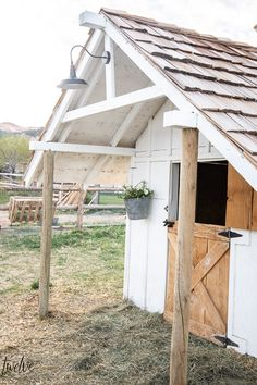 Check out this amazing simple and stylish white and rustic goat house! Looking for goat shed ideas? Check out this great little lovely goat barn!
