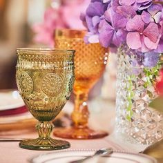 A colorful table setting mixing greens, purples and gold for this gorgeous event styled by the talented duo at @encre_dor   Styling: @encre_dor   Flowers: @blossom_tree_dubai  Stationary: @ewallsstudio  Location: @ooroyalmirage   Rentals: @partysocialuae    #Regram via @partysocialuae