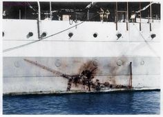 """Imprint of a Mitsubishi Kamikaze """"Zero"""" along the side of the H.M.S Sussex, a heavy cruiser with 4.5"""" of reinforced steel at the point of impact."""