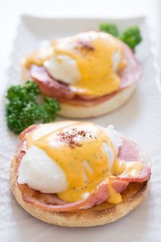 Tender poached eggs atop a seared slice of ham and a crusty english muffin. All enrobed in a velvety hollandaise sauce.