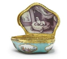 A GILT-METAL MOUNTED GERMAN TURQUOISE-GROUND PORCELAIN SHELL-SHAPED SNUFF-BOX WITH HINGED COVER, THE MOUNTS AND LIKELY THE DECORATION OF LATER DATE,