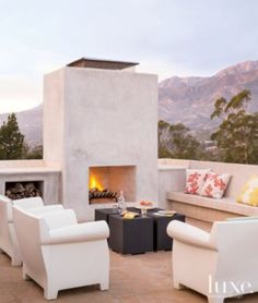 Modern Outdoor Terrace with White Concrete Fireplace #outdoor, #fireplace