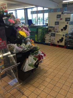 The flower section at the entrance of the store, typical of UK supermarkets/grocery stores