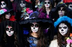 """Women with faces painted to look like the popular Mexican figure called """"Catrina"""" are seen in Zapopan"""