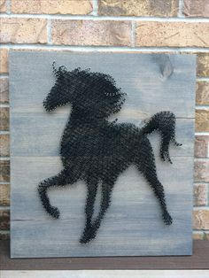 Large String Art of Black horse on grey stained double mounted board.  22 inches tall.  Made to order through my Etsy shop, NailedItCA The nails appear to shimmer when reflecting light...So pretty!!