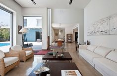 Villa: Indoor Wicker Chairs With Cream Seat Foam Mixed With Modern White Sofa Couch Also Brown Wooden Coffee Tables And Cool Floor Lamp Fir Small Space Linig Room Design Ideas: Exquisite Modern Villas Design