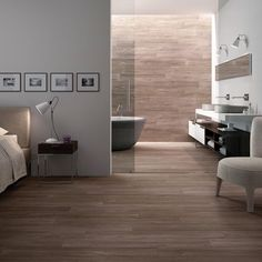 Timber Redwood tiles 1000 x 165mm. Wood effect tiles are so realistic that the natural beauty of wood grains and knots look like the real thing. The level of detail is impressive causing you to appreciate and examine the tiles. To introduce an element of nature into your décor design, Timber tiles are an ideal choice. https://www.tileflair.co.uk/product/timber-redwood #FloorTiles #Tiles #BeautifulTiles #WoodTiles