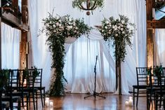 Ceremony arch flowers, arbor flowers, organic ceremony flowers, arch decor wedding, wedding ceremony decor, amazing arch flowers, garden wedding flowers, greenery, white and blush wedding flowers, ceremony draping for wedding, florals: Wildflowers LLC, photography: Eden Ingle, venue: One Cannery