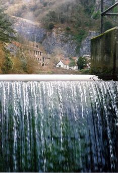 Cheddar Waterfall in the village of Cheddar, Somerset, UK. The Cheddar Cheese originated here