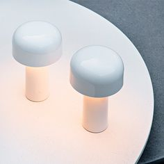 The Flos Bellhop Table Lamp by Barber Osgerby for Flos is a portable, battery powered LED lamp with 4 step dimmer. Buy Flos Lighting from Utility Design today. White Table Lamp, Light Table, A Table, Table Tambour, Table Rose, Contemporary Table Lamps, Modern Table, Modern Lamps, Portable Table