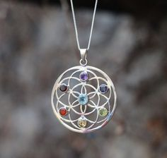 This beautiful pendant in our Sari Stone String collection was handmade in a small home-based workshop in the historic old city of Jaipur, India. Round Pendant, Chakra, Healing, Pendant Necklace, Gemstones, Silver, Handmade, Jewelry, Style