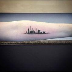 Single needle New York skyline tattoo on the left inner forearm....