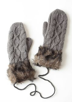 Love!!  Catching Snowflakes Faux Fur Mittens 18.99 at shopruche.com. Finished in a gray cable knit, these cozy fleece-lined mittens feature a faux fur trim and gray laces that can be tied to keep the mittens stored as a pair.10