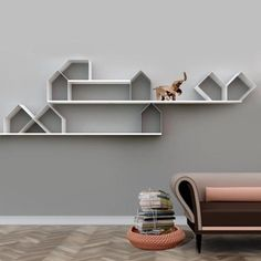 This modular shelving system is comprised of sheet iron house-shaped modules that are linked together by small magnets—a simple function that allows for various kinds of configurations.