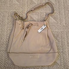 """NWT DKNY Shoulder Handbag NWT Color: nude About 15"""" wide and 13.5"""" tall DKNY Bags Hobos"""