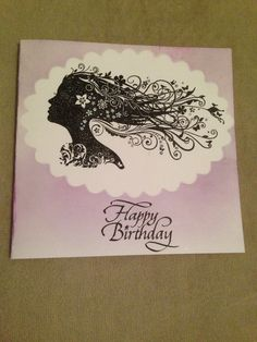 A simple card using distress inks and a indigoblu stamp in the middle