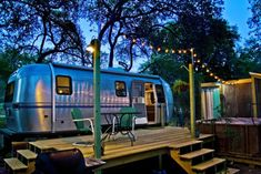 """The Dixie Daisy is the best of both worlds. You'll feel like you're """"roughing it"""" while being surrounded by elm trees on a 10-acre property along the banks of Smith Creek, but the shops and restaurants of downtown Wimberley are just three miles down the road."""