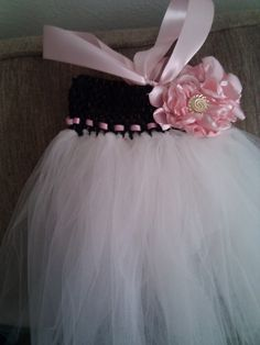 Kayla this is a tutorial on one way to do it of course you could use more tulle to make it stand out more and longer pieces to make it longer but this is how easy it can be! Lol