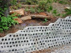 recycled retaining wall | Retaining wall made from recycled beer bottles imbedded in concrete ...