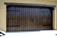 1000 images about doors on pinterest castle doors for Faux wood garage door prices